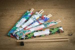 chopsticks in colorful, 4c printed paper sleeve for lovepiecepoke in Vienna