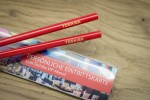 red chopsticks with laser engraving as invitation to a VIP event